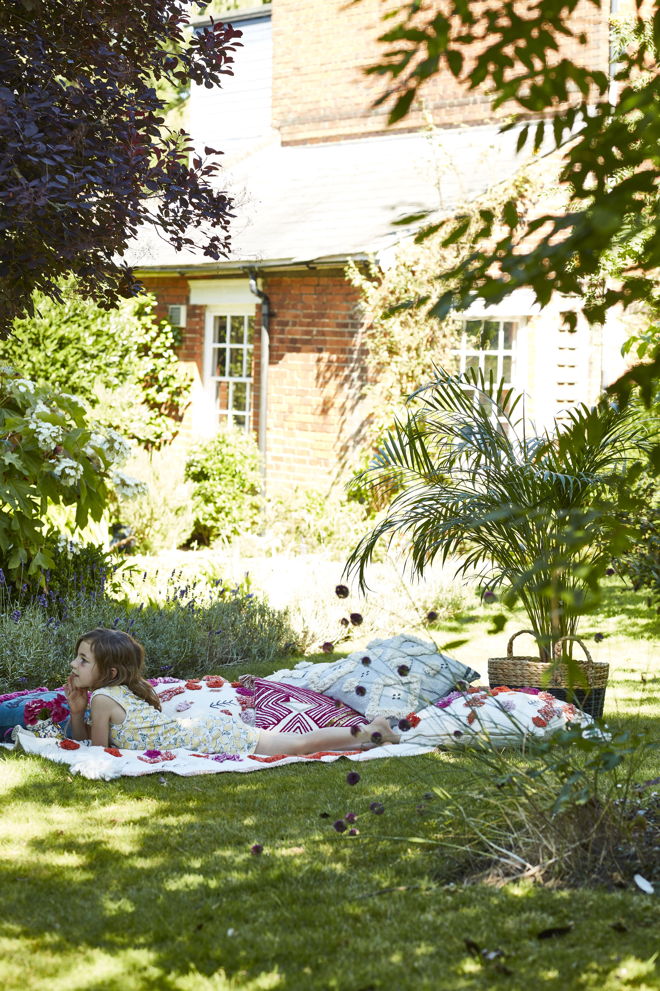 All cushions from  Anthropologie . Wicker basket,  H&M