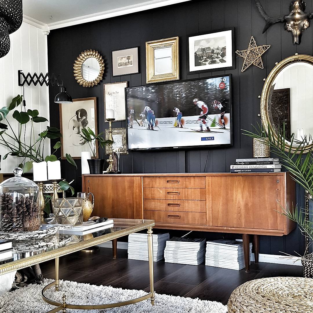 Hildegard's favourite rooms are the living room and kitchen. The Black wall really allows the art to stand out and is beautifully complimented with the vintage sideboard.