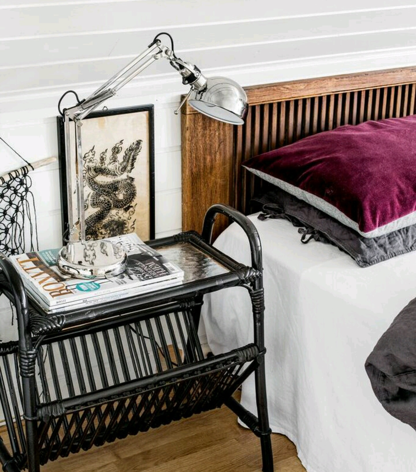 The couple's bedroom is bright and airy. The bedside table is another flea find that Hildegard painted.