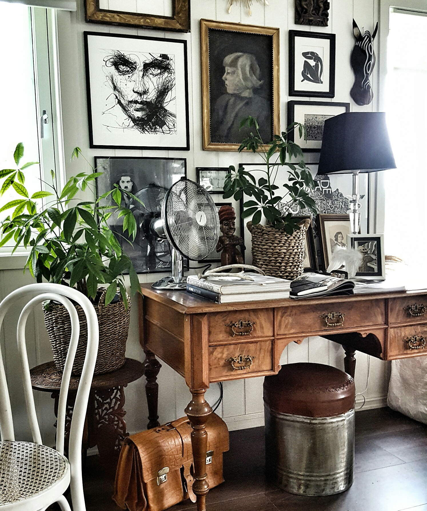 A stunning Gallery wall, art features all over this house.