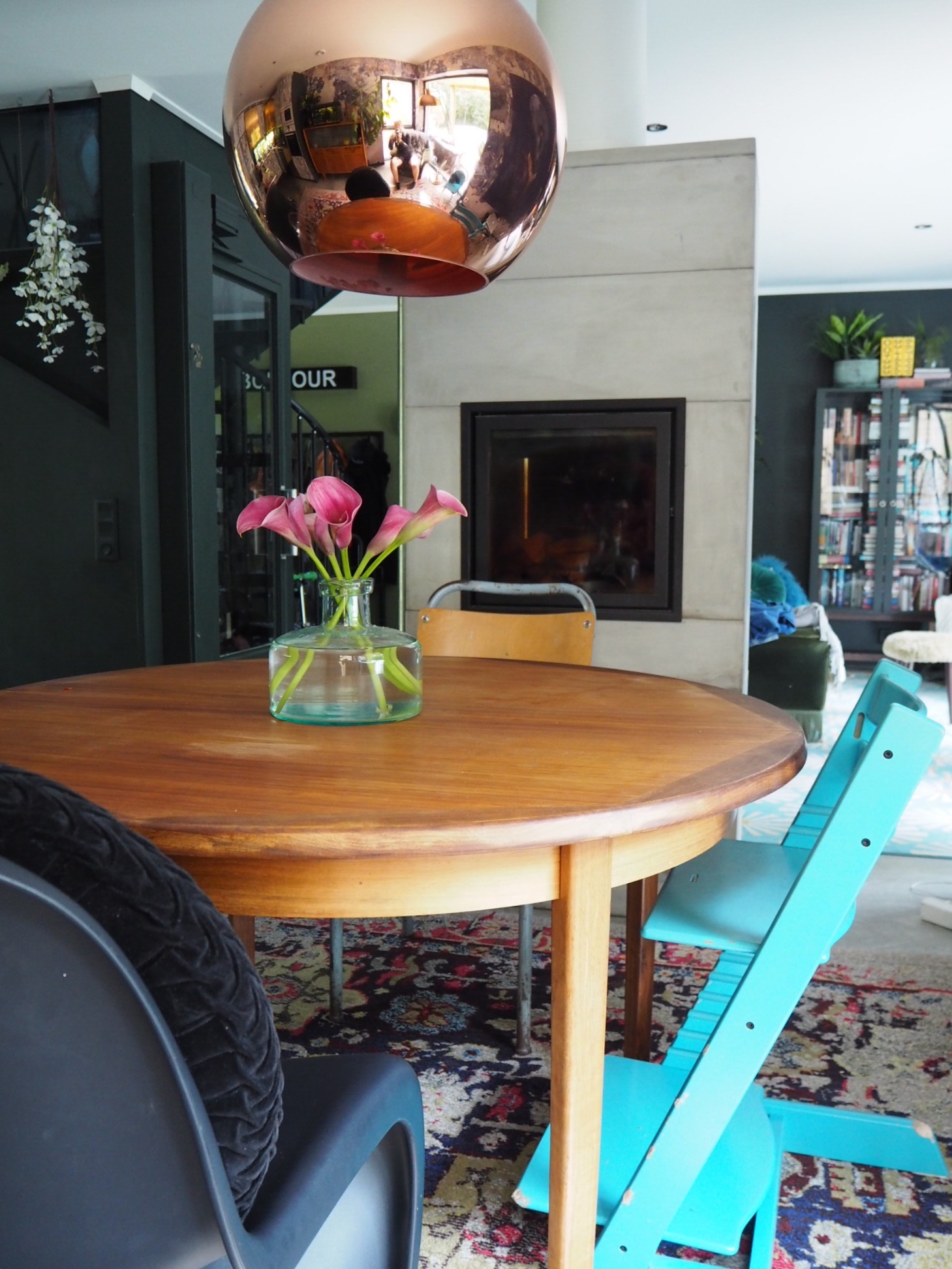 mismatched chairs give an eclectic look to the dining room