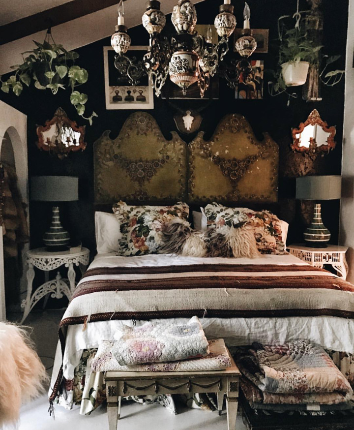 """Judy recently painted a black wall in her master bedroom, which for a dark lover like me, shows off her fabulous textiles to perfection. Textiles that Judy sources from around the world. """"the dark colour makes the headboard pop"""" says Judy."""