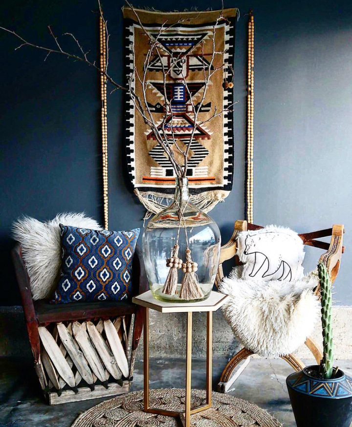 Vintage furniture against ethnic art and cushions