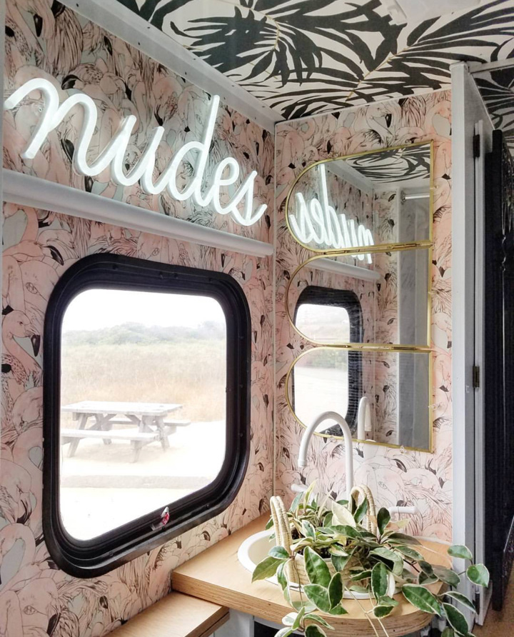 """The bathroom. Flamingo Wallpaper from @newwall. """"nudes"""" sign from @britelitetribe. The mirror I found at the thrift store and the sink was also painted with the tub resurfacing kit. We found the  faucet  online, it's made for RV's and it's plastic."""
