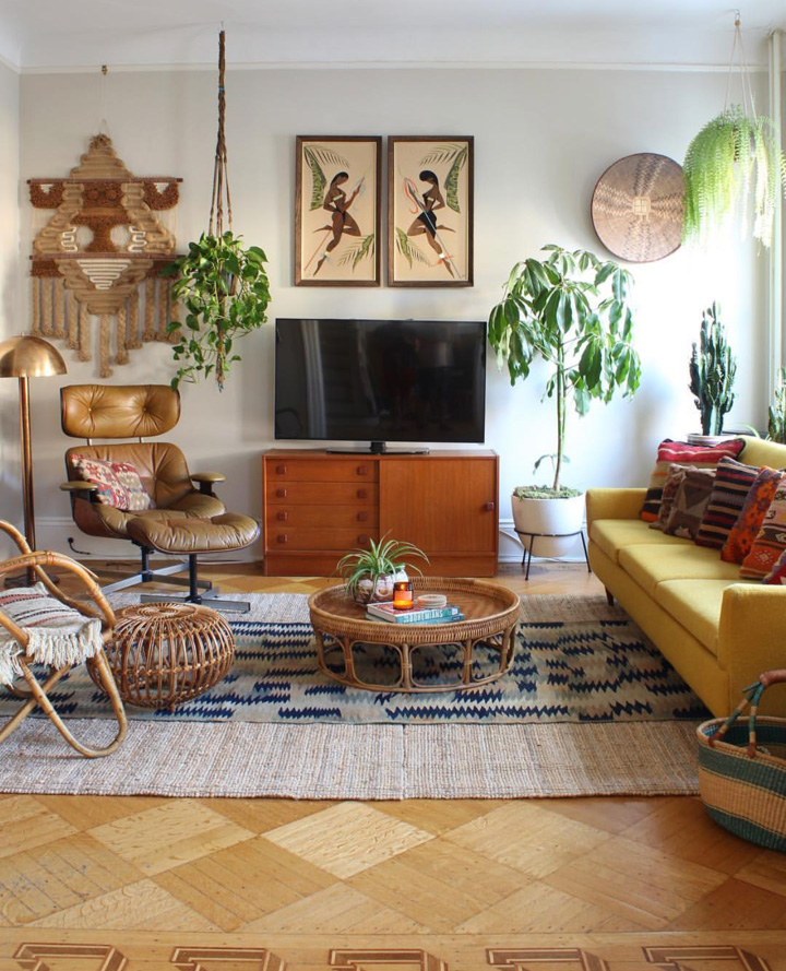 Mis-matched furniture, mid century finds, plants and textiles create a relaxed vibe in this room