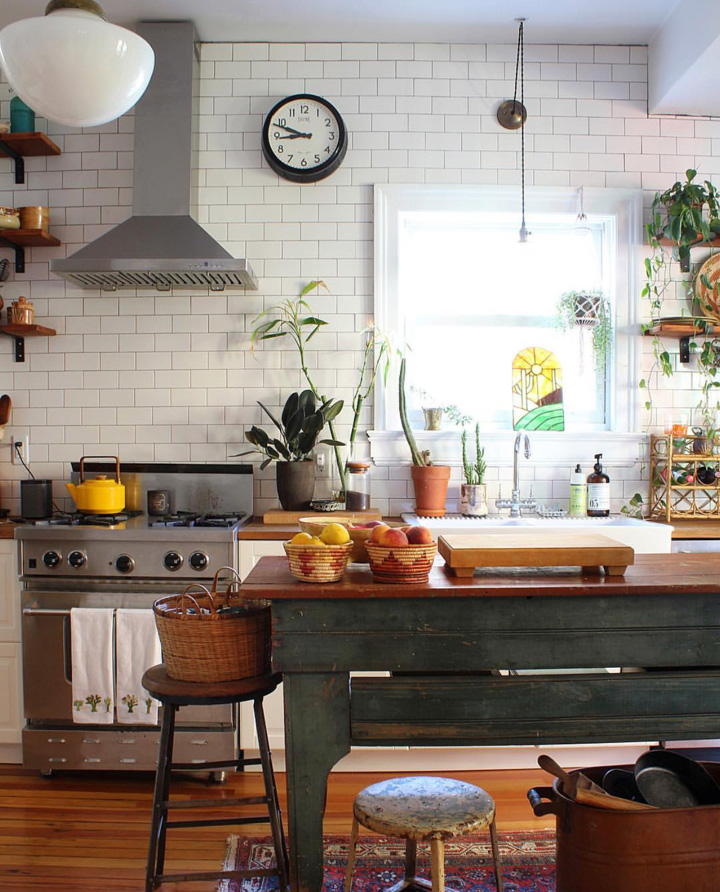 In the kitchen, the units were ripped out and replaced with ones by ikea. In keeping with the vintage look the pair go for a cabinet from 1800 is used as a work table.