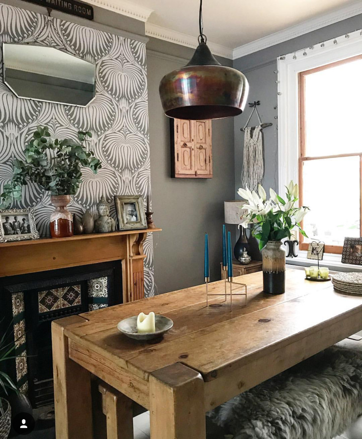 A rustic table with Industrial lighting.