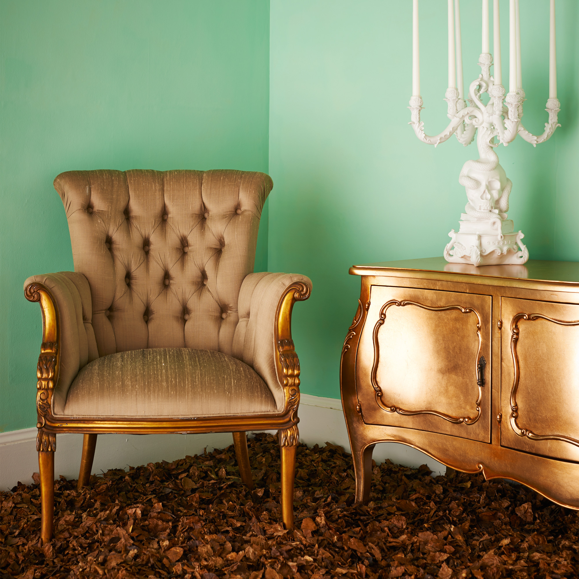 french chair and gold sideboard.jpg