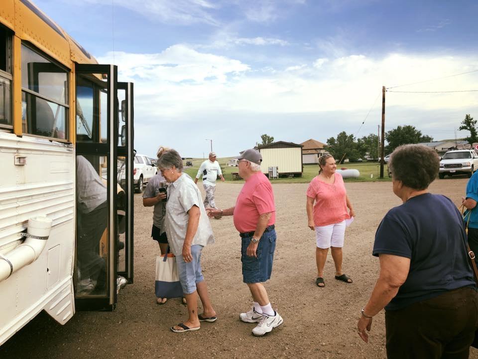 Patti Cavanaugh, Senior loading the bus for Swan Creek Docks..jpg