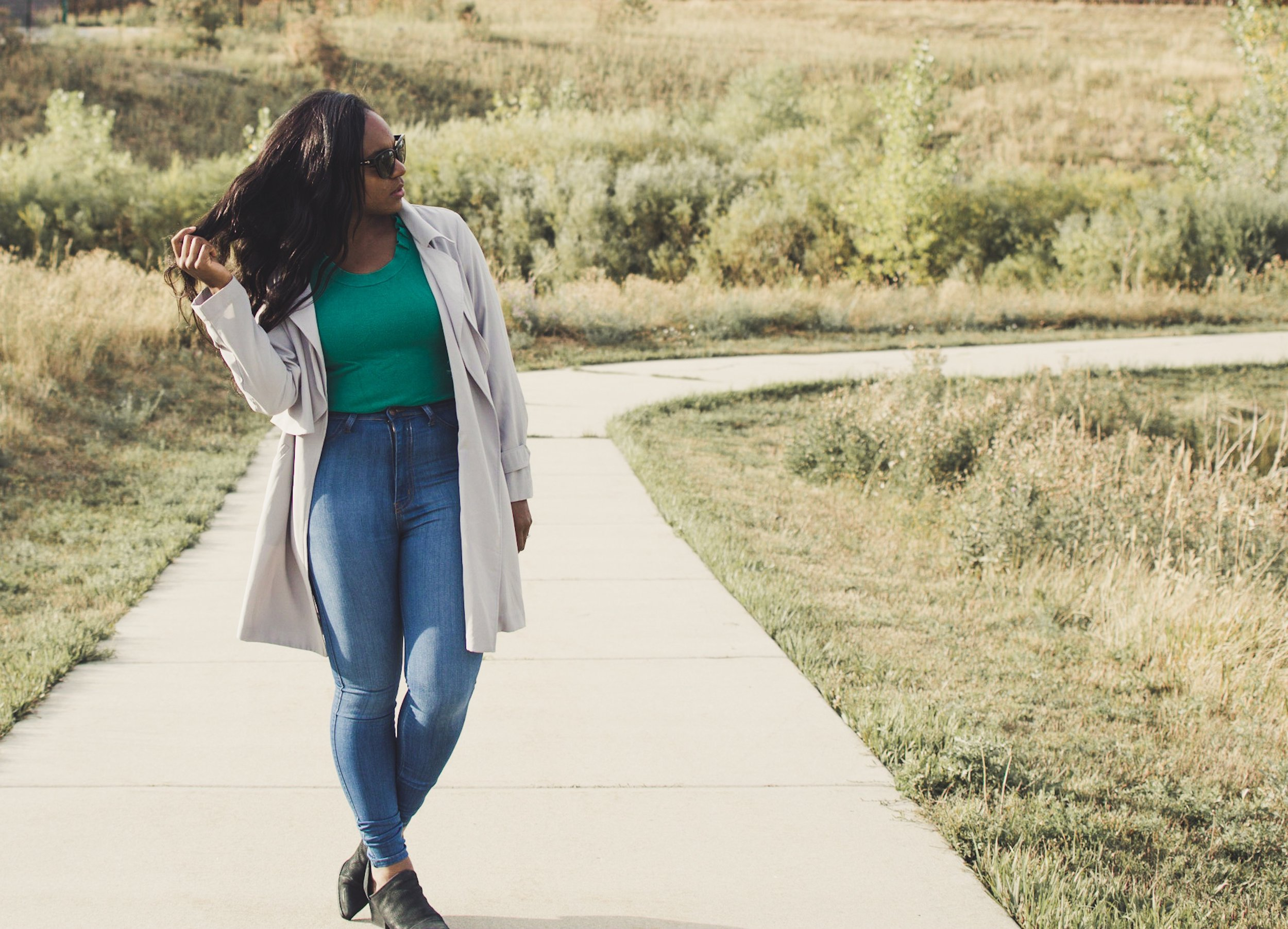 Duster jacket: Michael Kors; Jeans: FashionNova; Top: New York and Company; Booties: Steve Madden