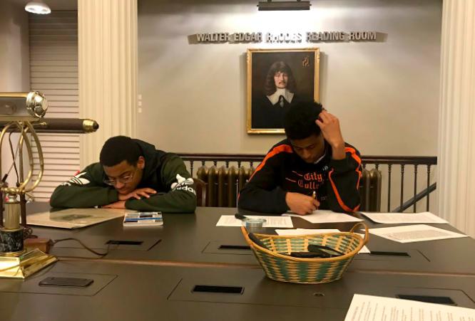 Students Amir and Gyasi researching at the Maryland Historical Society.
