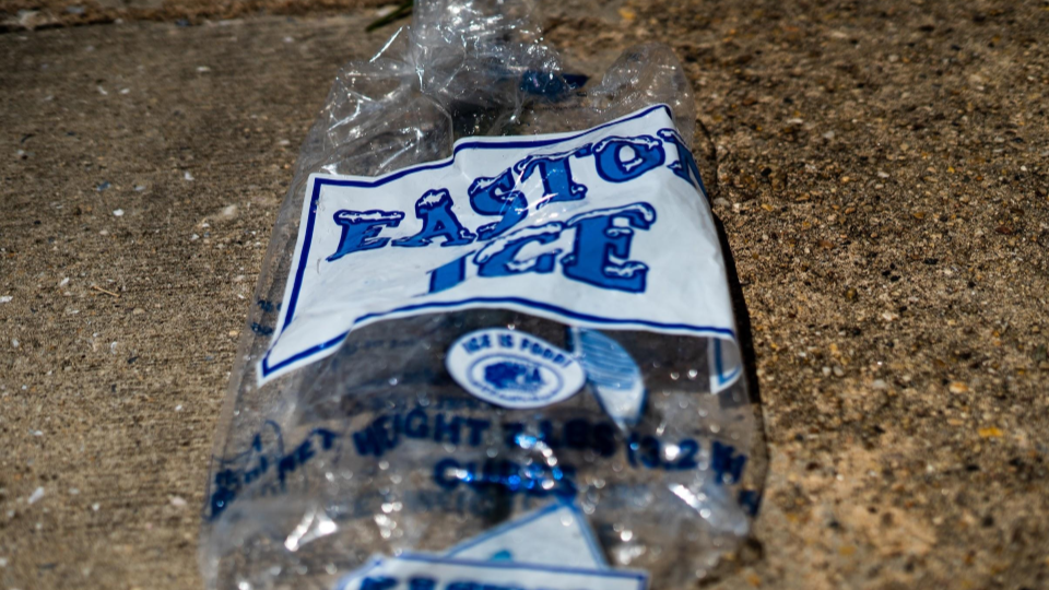 Ice bags litter the streets of McElderry Park in the summer as residents attempt to cool off (Justin Marine).