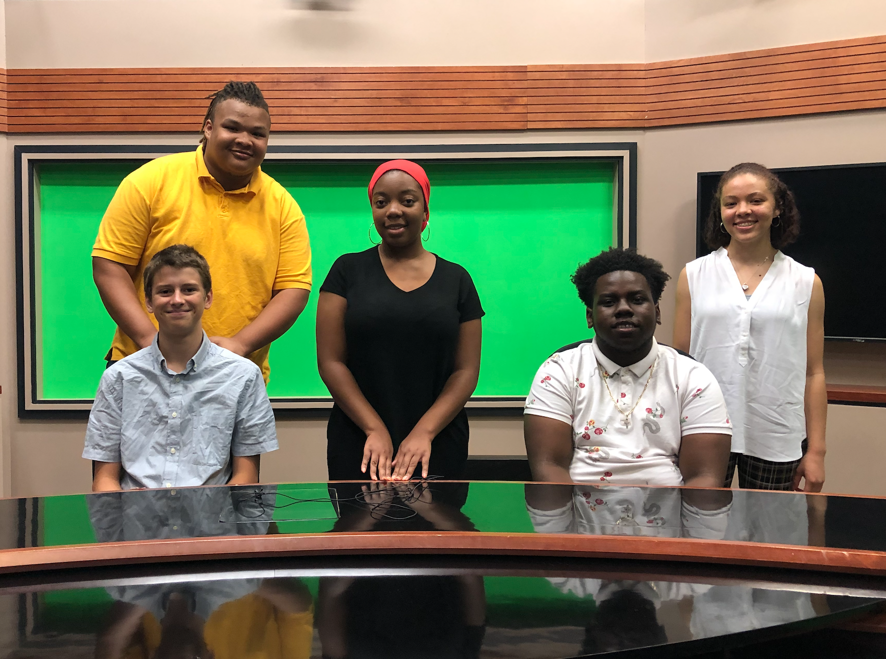 Journalism Team's field trip to The Richard Eaton Broadcast Center at the University of Maryland, home to UMTV and the Maryland Capital News Service (CNS) Broadcast Bureau. From left to right: Otto, Justice, Katia, Justin, and Sonia.