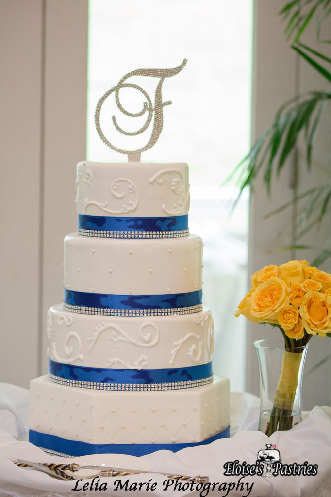 Stunning White Cake with Blue/Silver Ribbons