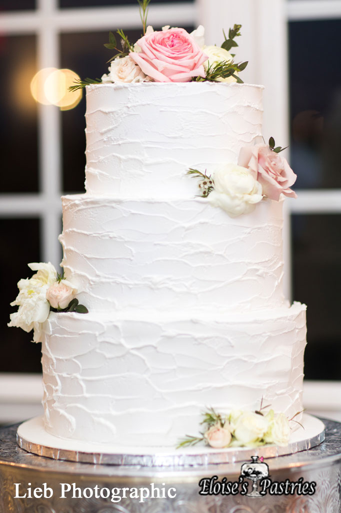 Simply White Wedding Cake with Flowers
