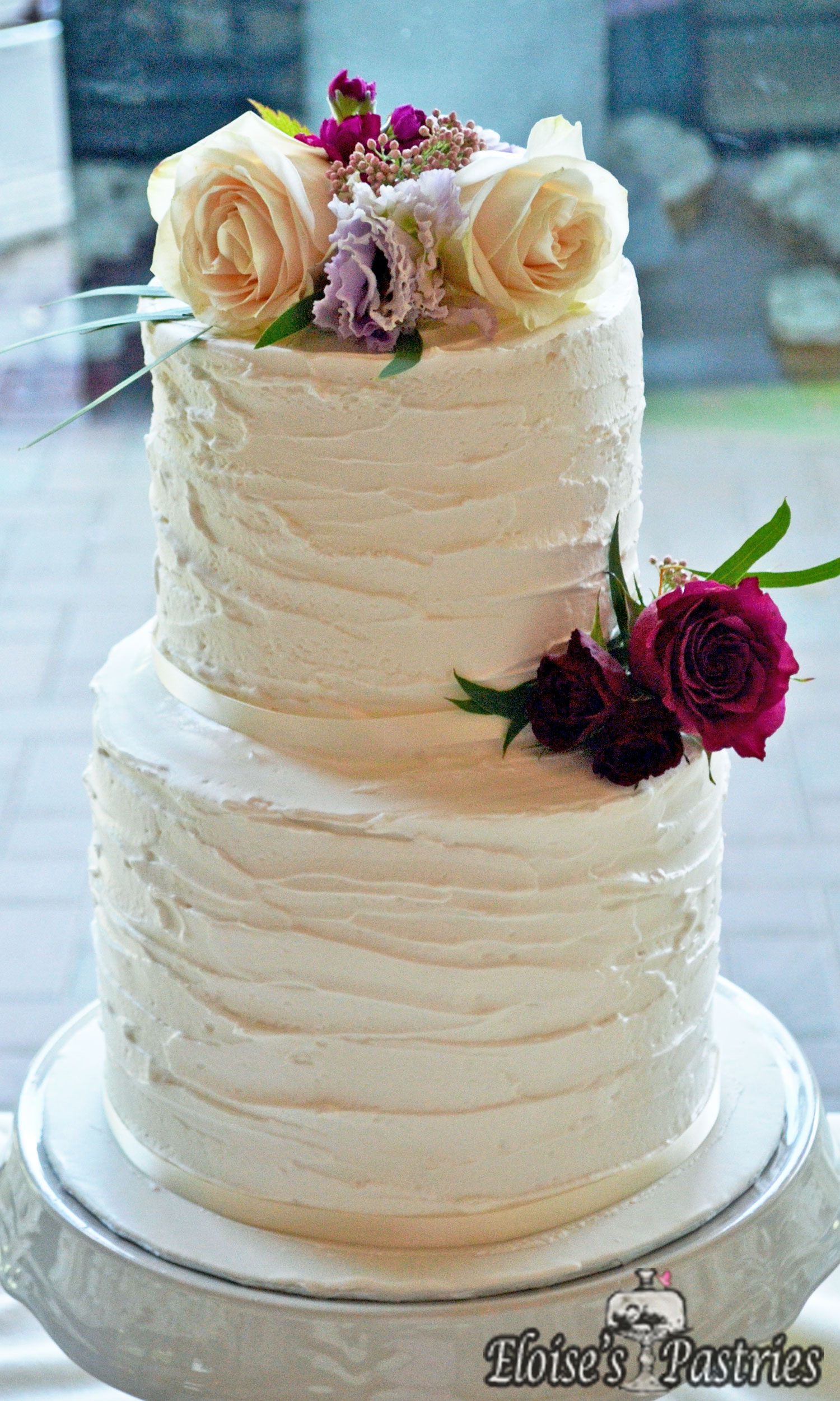 Simple and Classic Buttercream Wedding Cake with Flowers