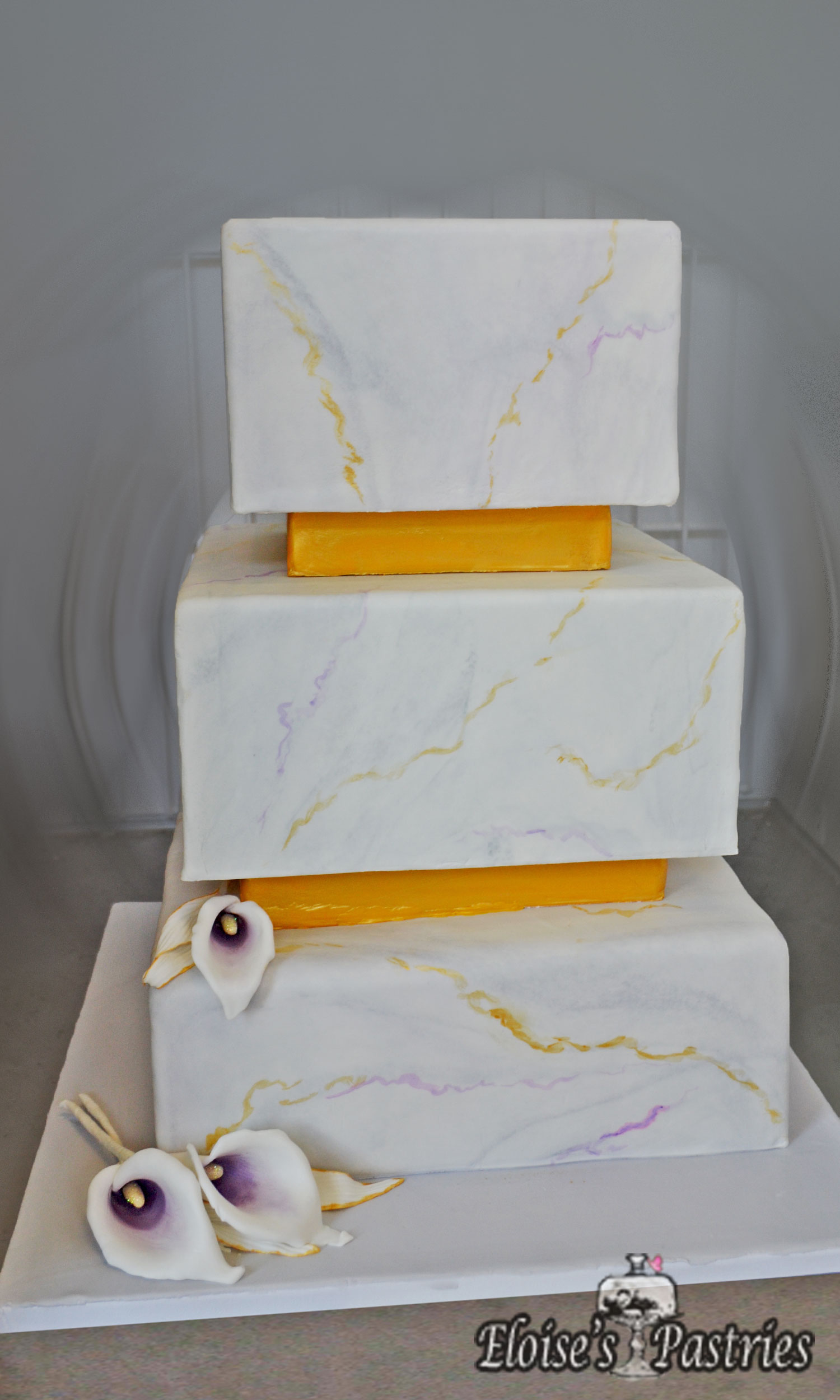 Beautiful Square Marble Wedding Cake with gumpaste Cala Lilies