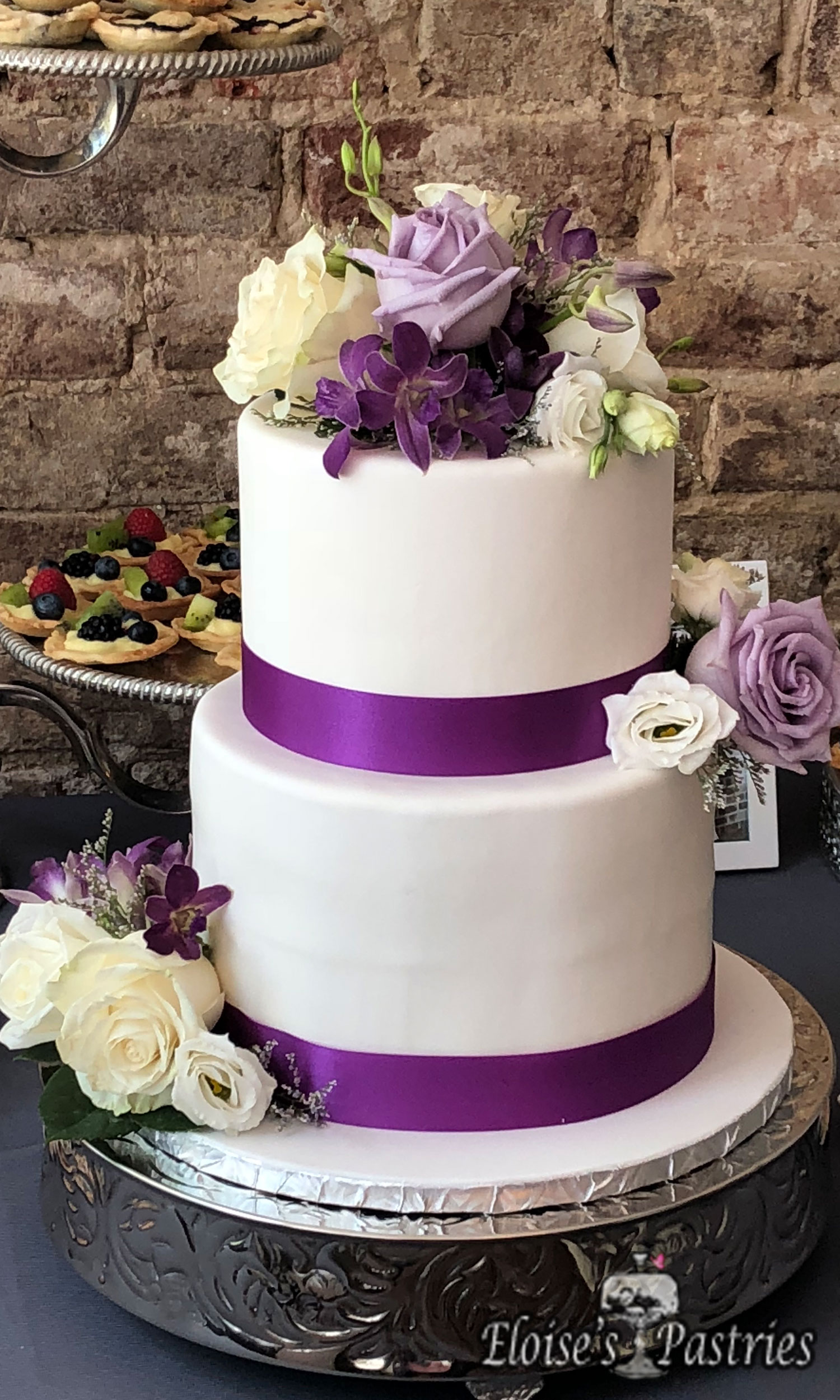 White and Purple Two Tier Wedding Cake