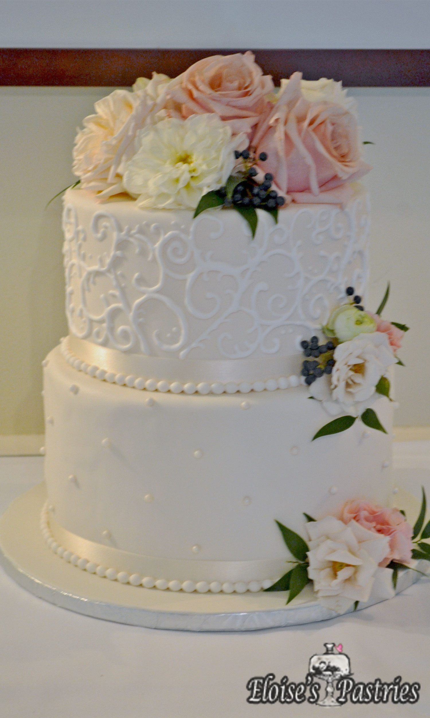 Traditional White Two Tier Wedding Cake with Flowers