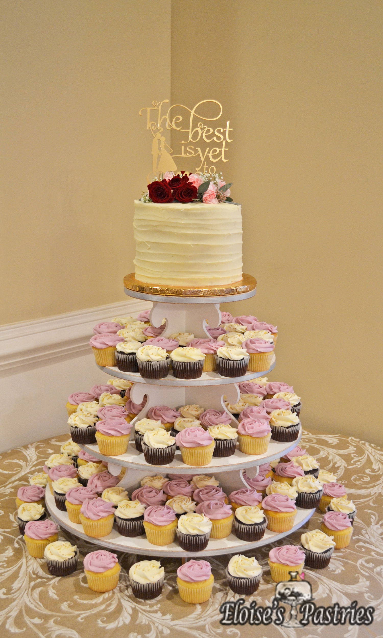 Blush and White Wedding Cake and Cupcakes