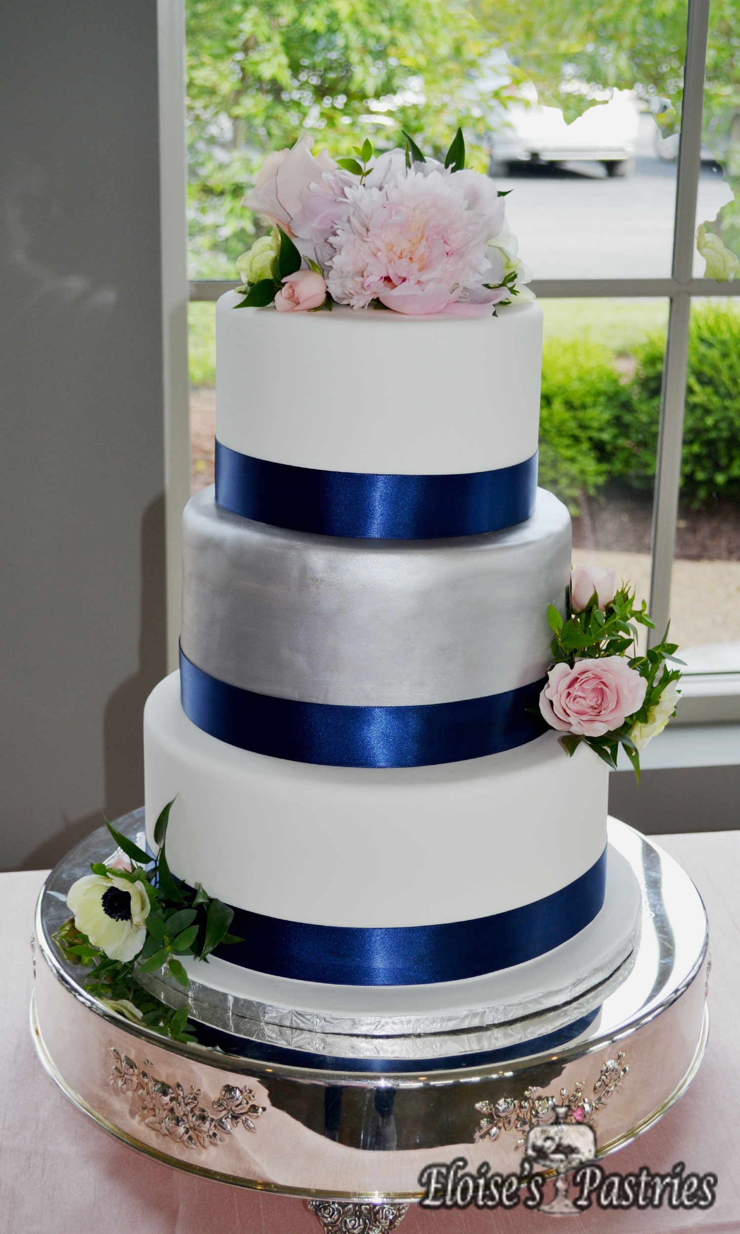 White, Silver and Blue Wedding Cake