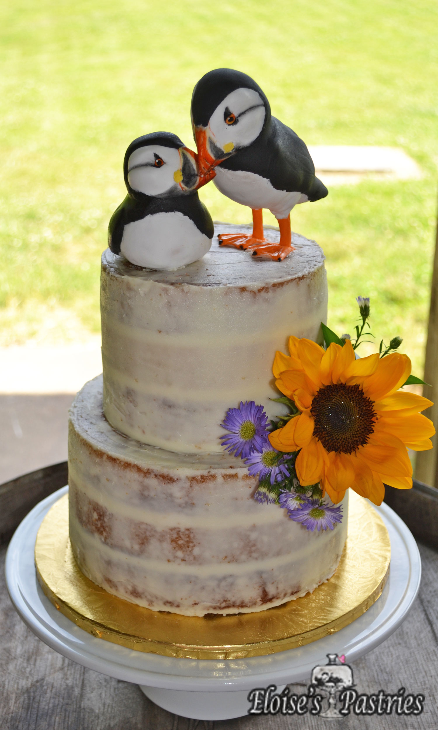 Naked Wedding Cake with Custom (edible) Puffins Topper