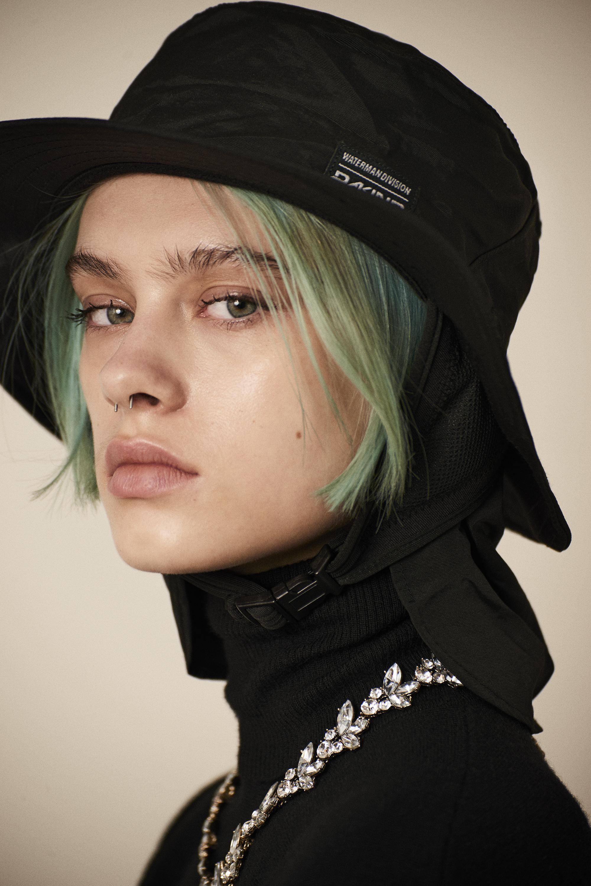 Turtle neck wool sweater  Saint Laurent . Hat  Dakine . Necklace  Givenchy
