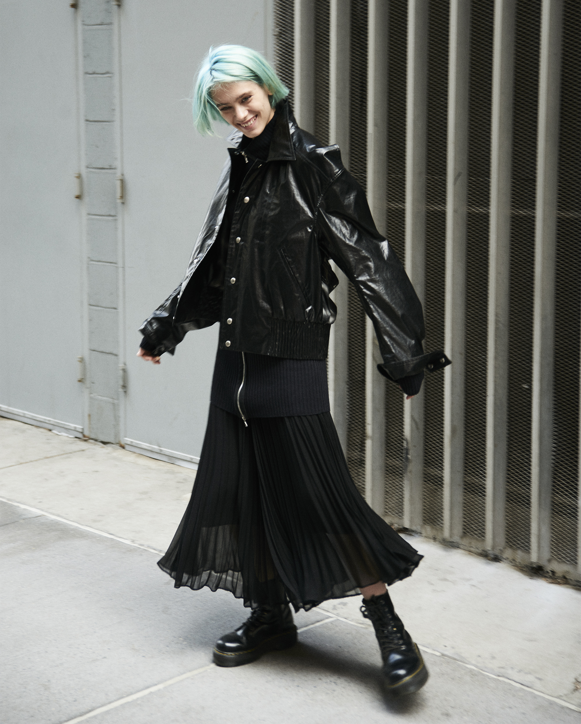 Jacket  Private Policy . Long rib sweather  Rick Owens . Pleated long skirt  Saint Laurent . Boots  Dr. Martins