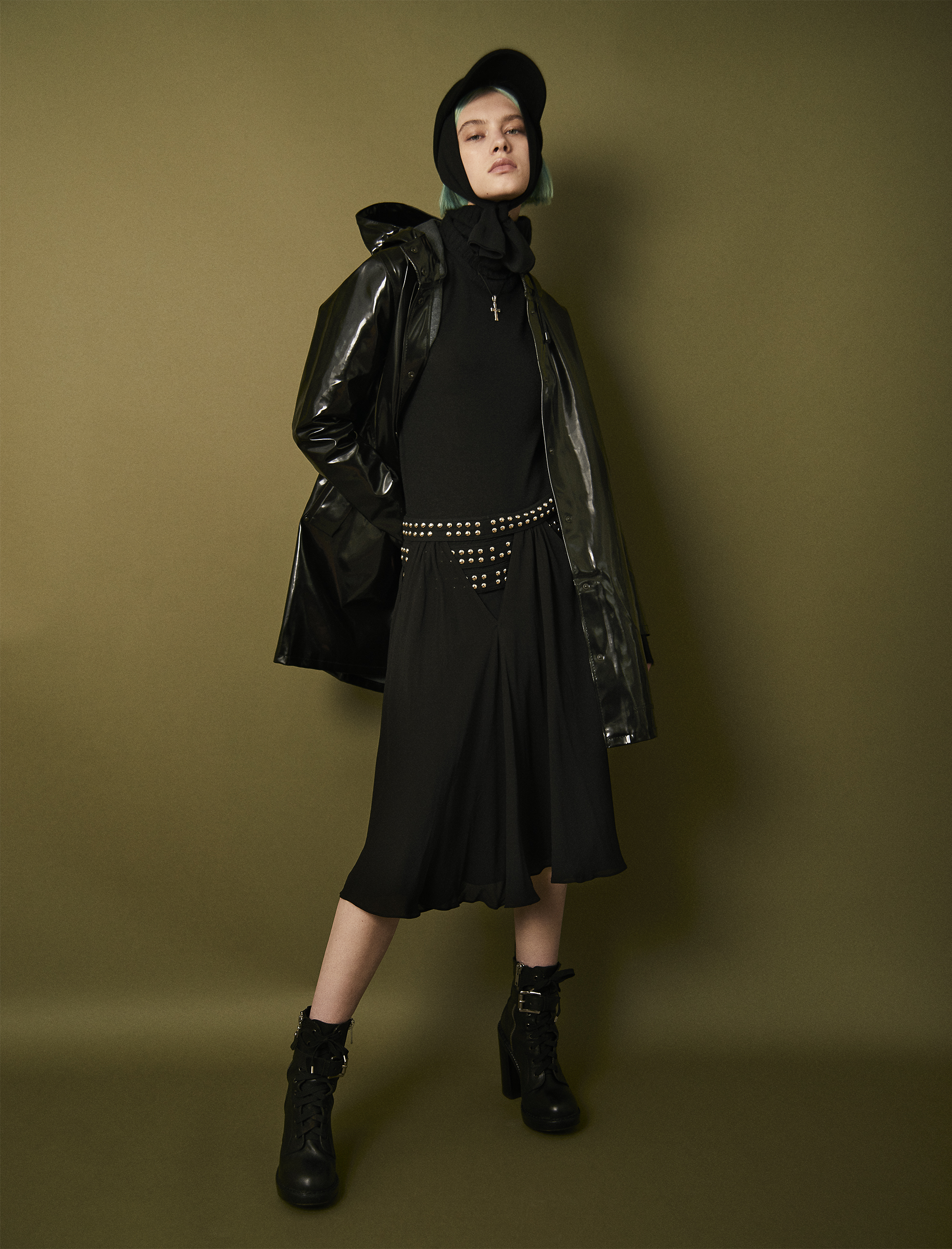 Rain coat  Stutterheim . Turtle neck sweater  Prad a. Skirt and boots vintage  PHI . Leggings around head  Wolford . Baseball cap  Epoch . Necklace Sasha's own