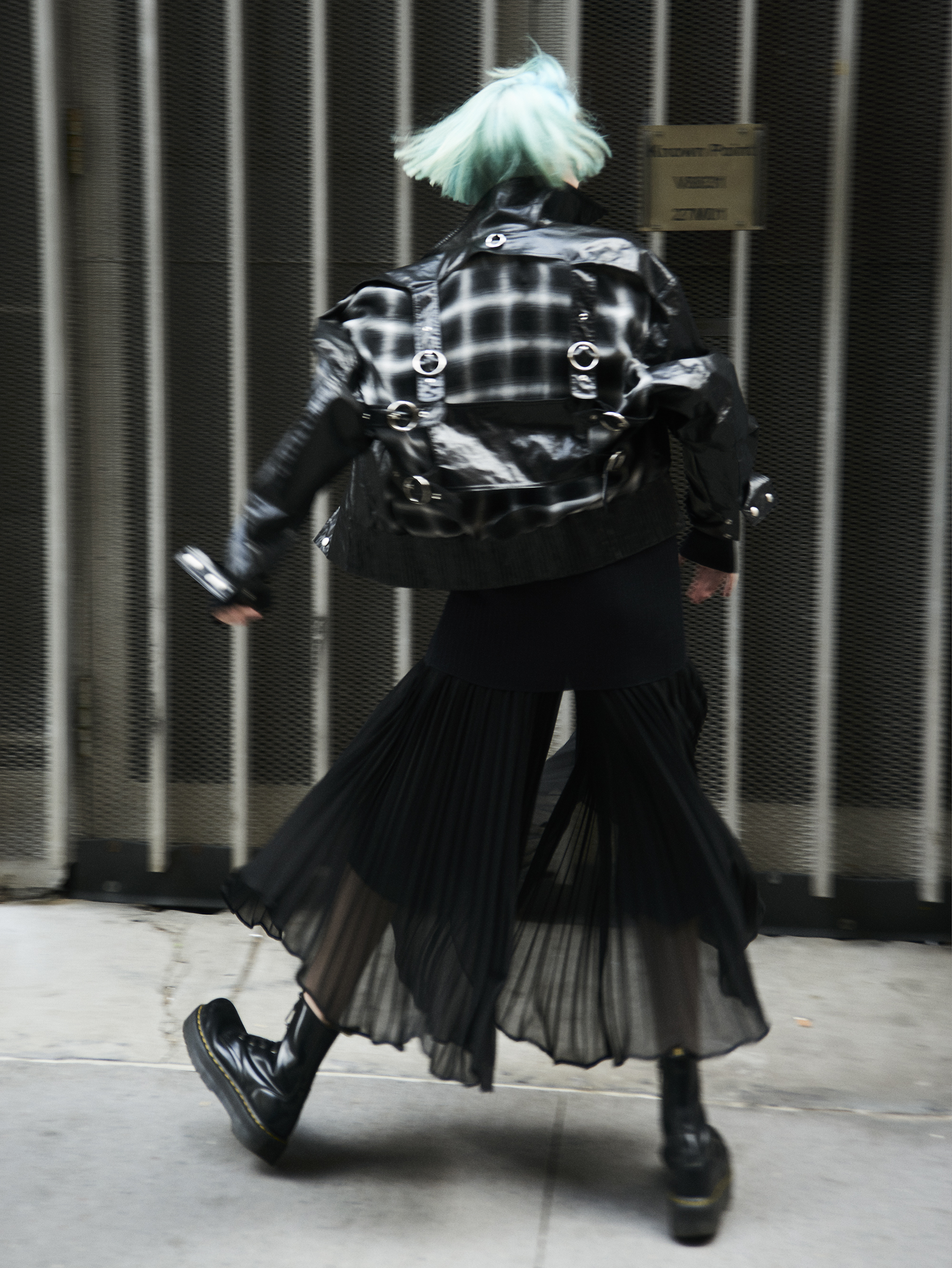 Jacket  Private Policy . Pleated long skirt  Saint Laurent . Sweater  Rick Owens . Boots  Dr. Martins.