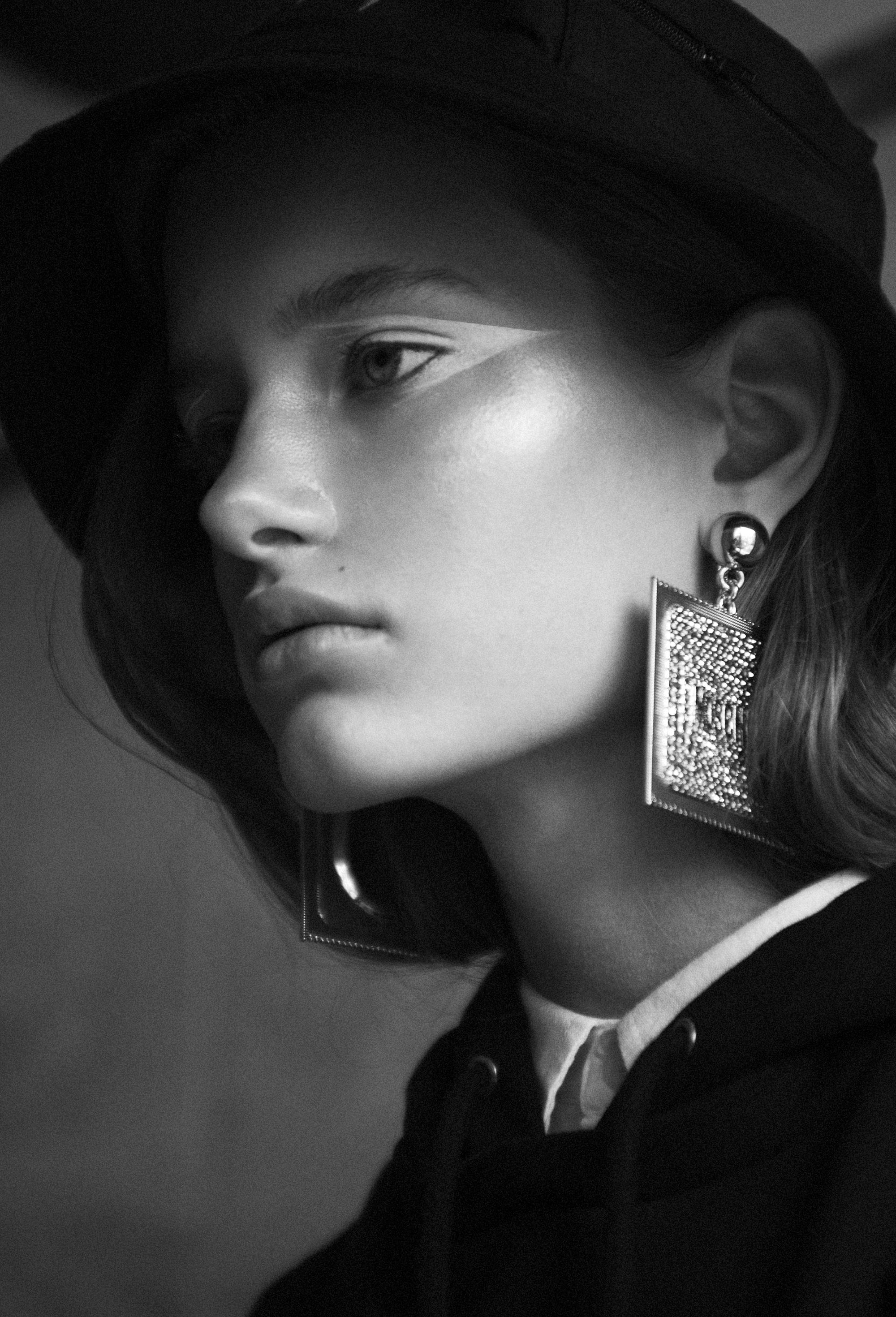 Bucker Hat  Prada.  Jumper  Balenciaga . White shirt  Acne Studios . Earrings  Moschino X H&M