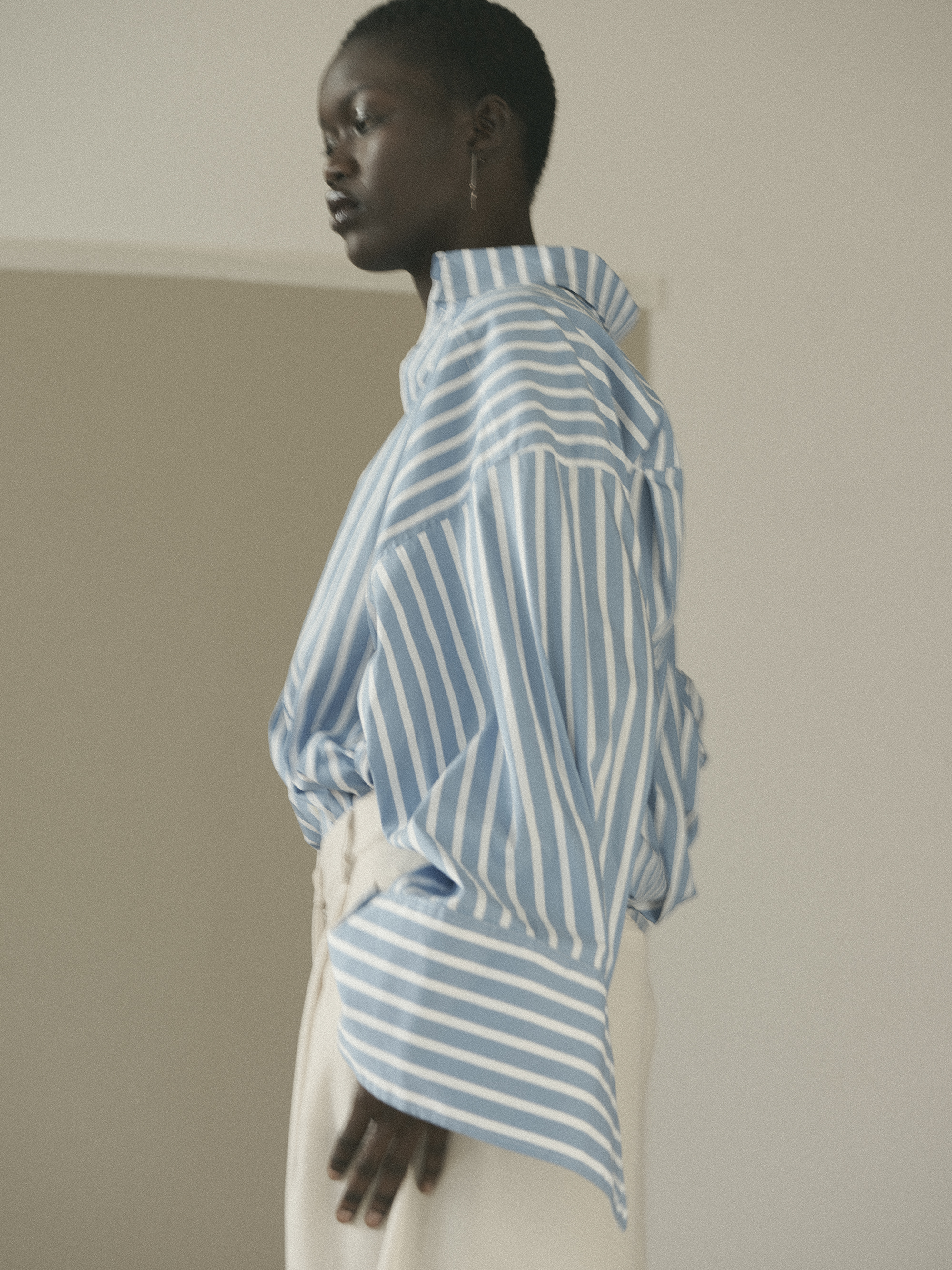 Oversized striped shirt with oversized cuffs  Schuellerdewaal . Off white oversized pants  ESSENTIAL ANTWERP