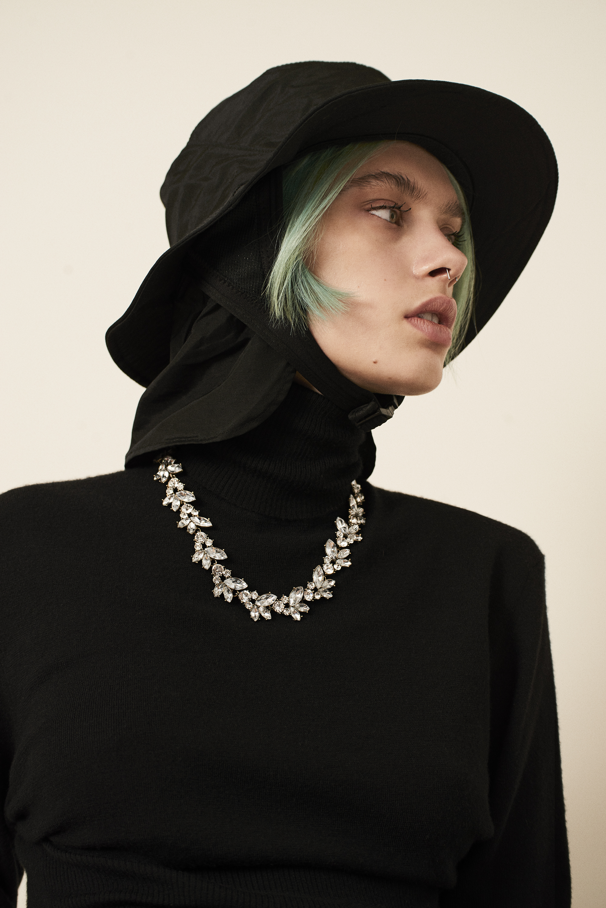 Turtle neck sweater  Saint Laurent . Hat  Dakine . Necklace  Givenchy