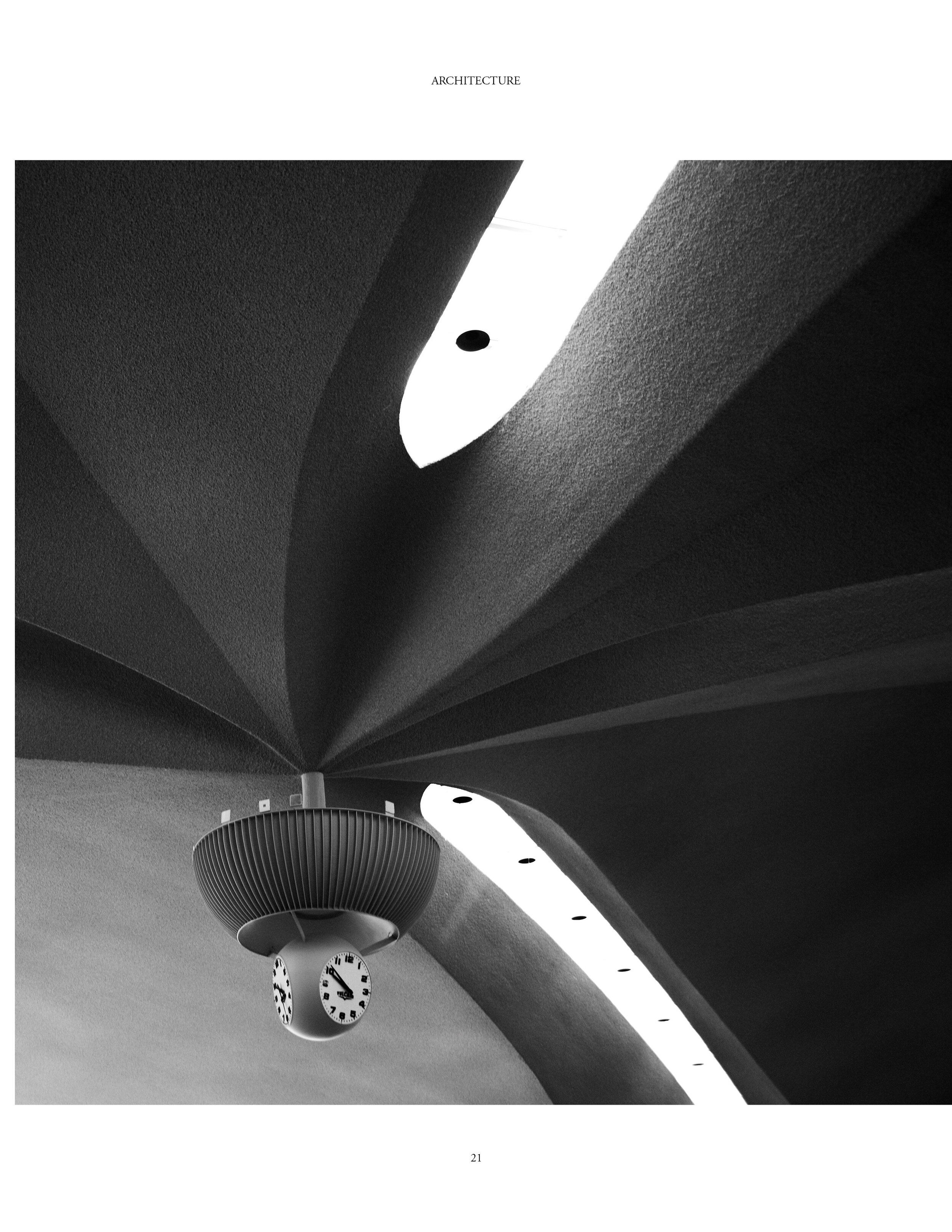 In the center of the terminal's ceiling, a Swiss Vulcain clock ticks on. The fully restored terminal houses the TWA Hotel's lobby, conference facilities and several restaurants and bars, including the original Paris Café. Saarinen's famous tubular passageways connect the building to the new terminal surrounding it.
