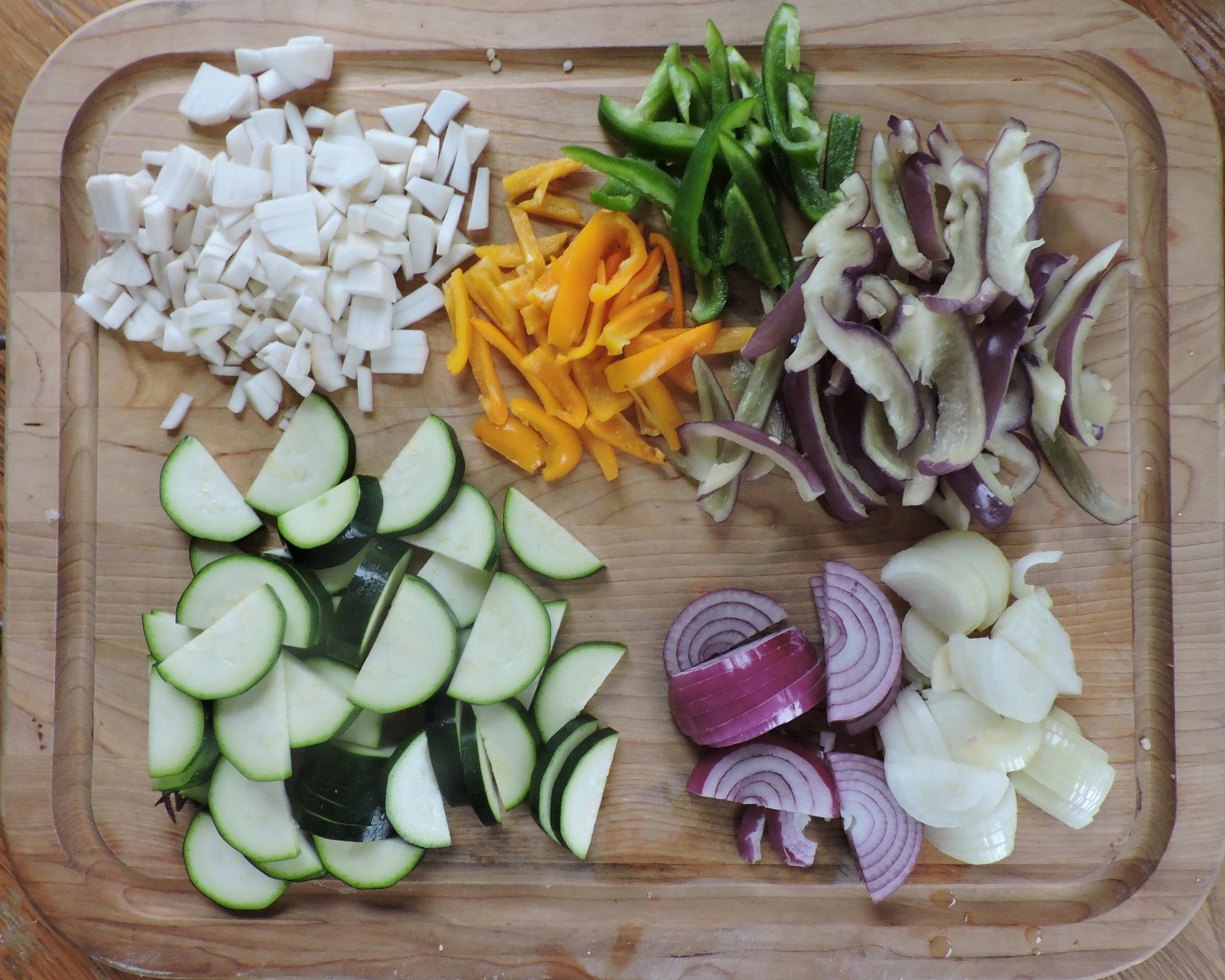 TOP: Turnips, orange, green, & purple peppers. BOTTOM: Zucchini, red & yellow onions.
