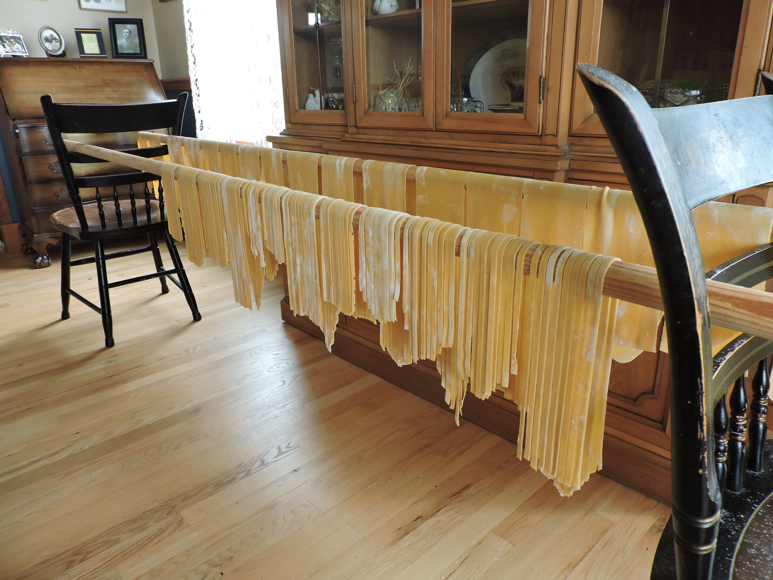 Both cut strands and pasta sheets drying midway through cutting pasta. I'm doing three batches here as I was making two for the family and one as a postpartum meal for a friend.