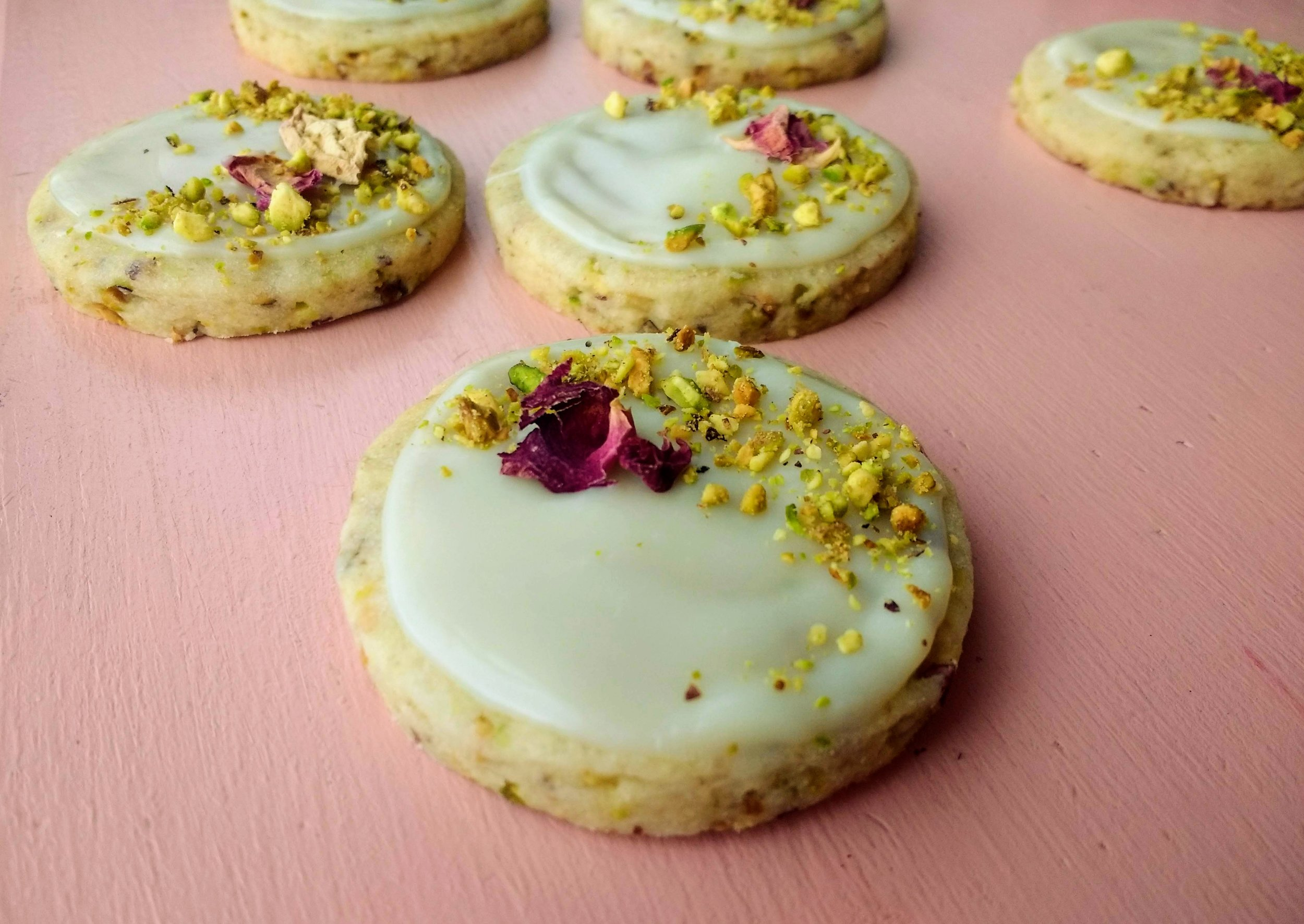 Beneath the Crust: Pistachio Rose Shortbread Cookies with White Chocolate Glaze