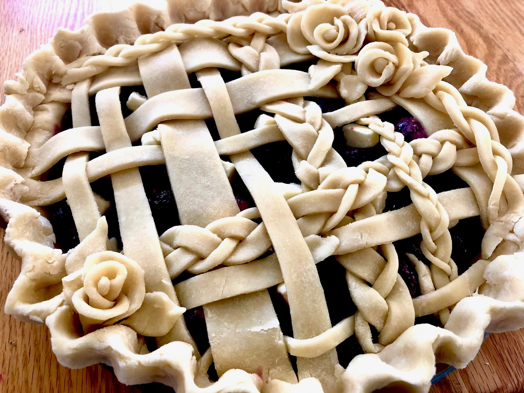 whimsical braided lattice on blueberry pie: beneath the crust