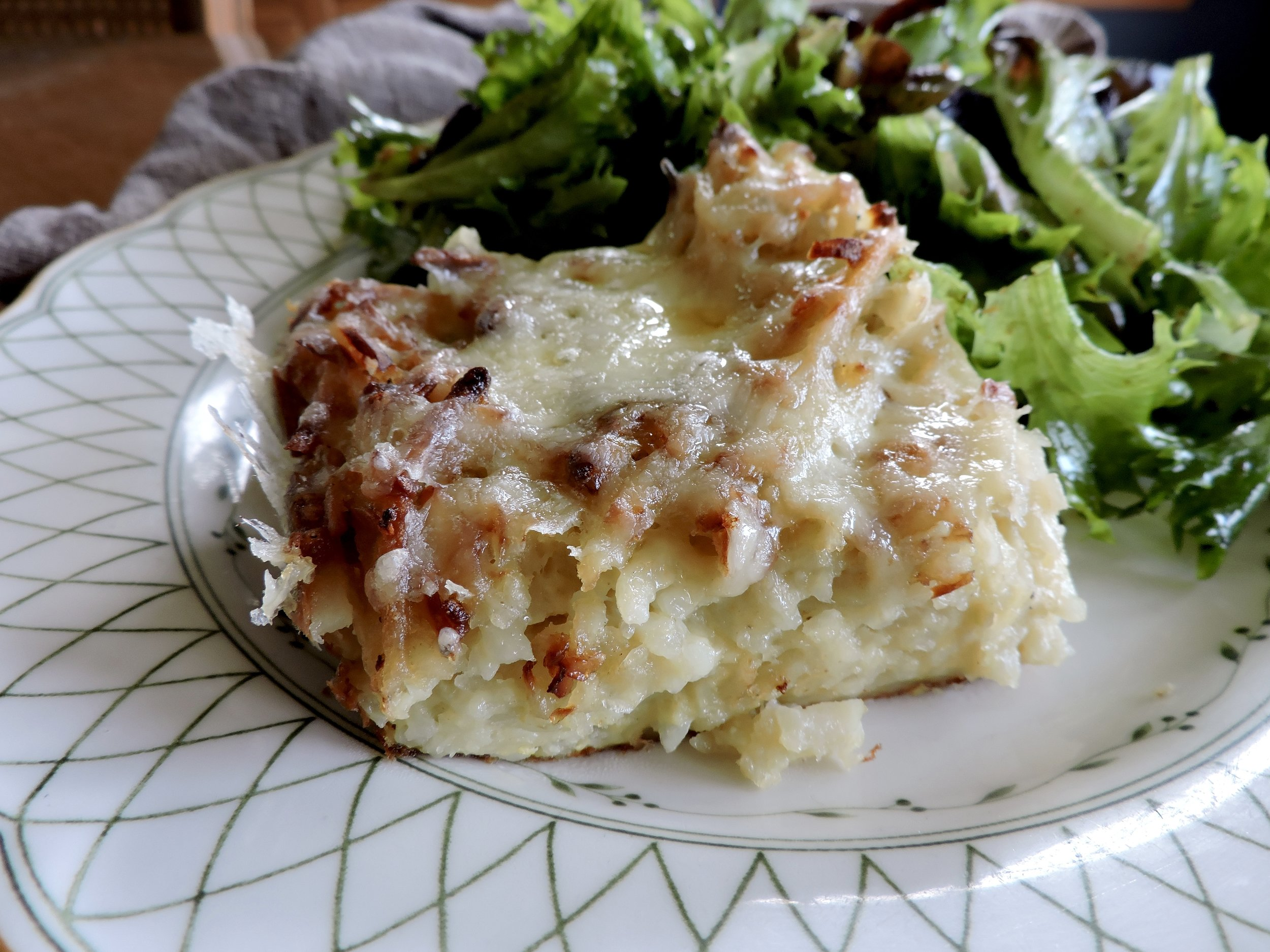 Here, potato kugel with cheesy delight.