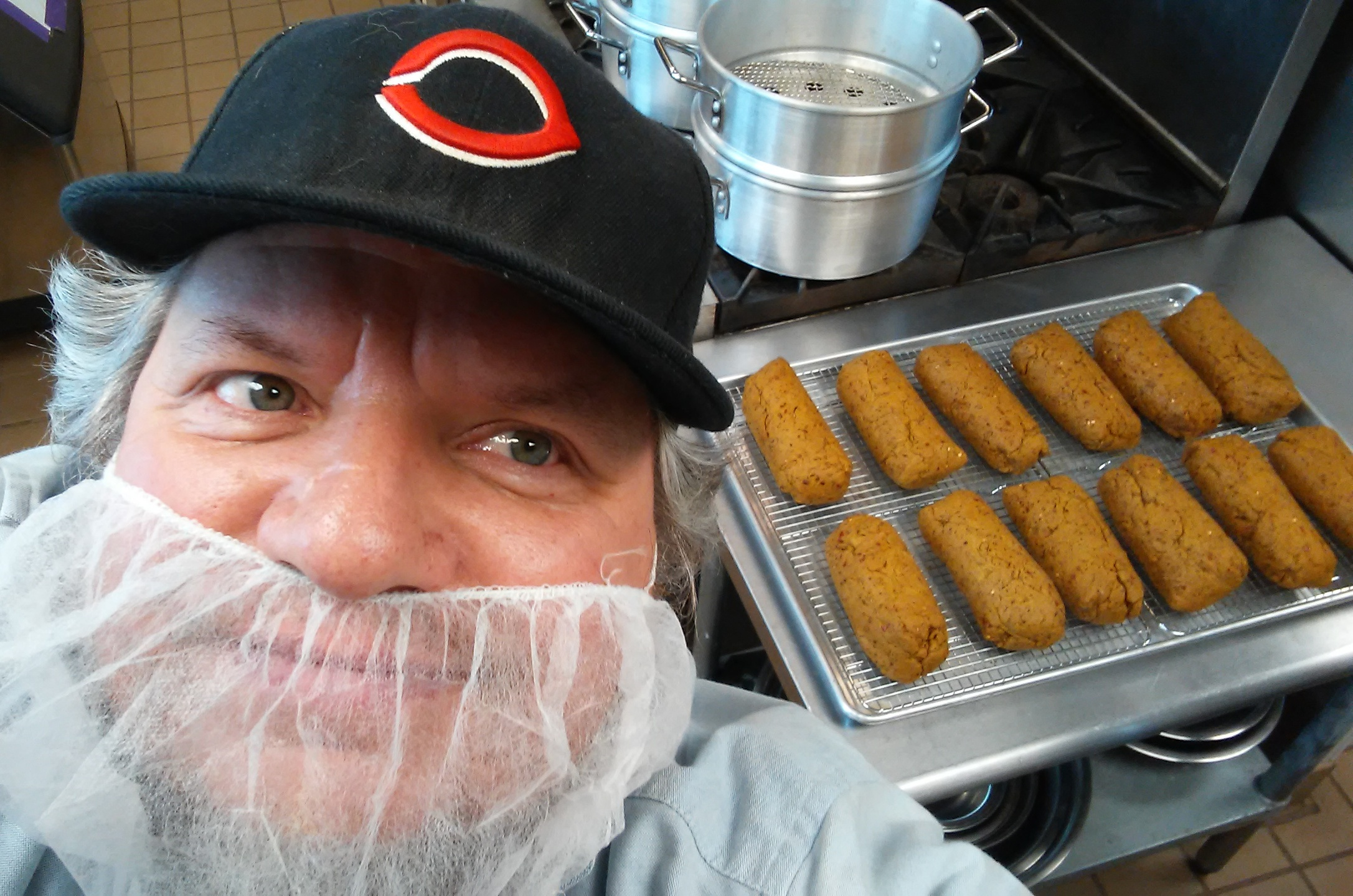 Shane in the kitchen with a fresh batch of Bangers.