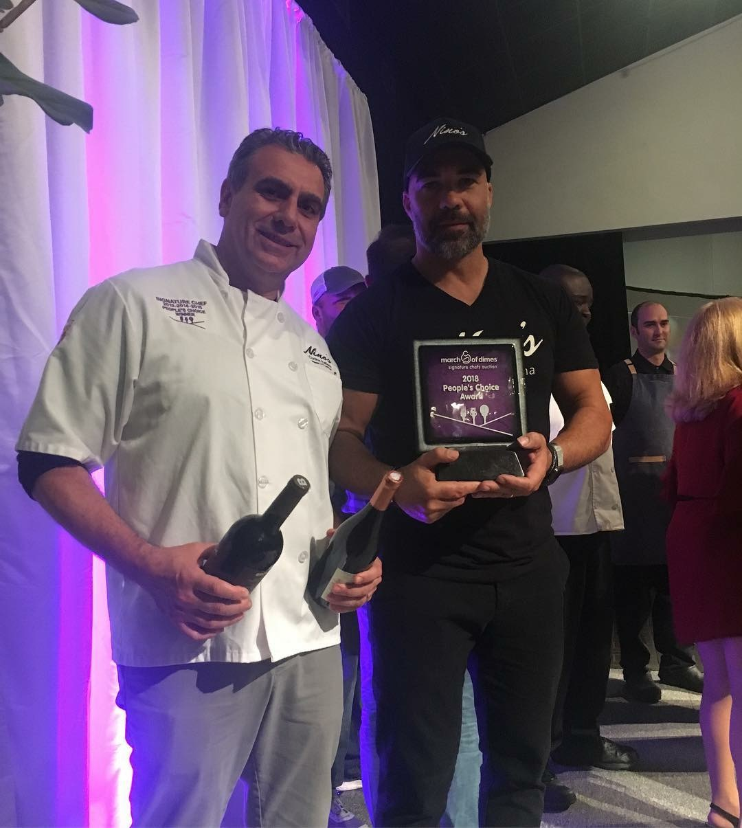 """Pietro Passalacqua and Massimo Mannino accepting the March of Dimes """"People's Choice"""" Award."""
