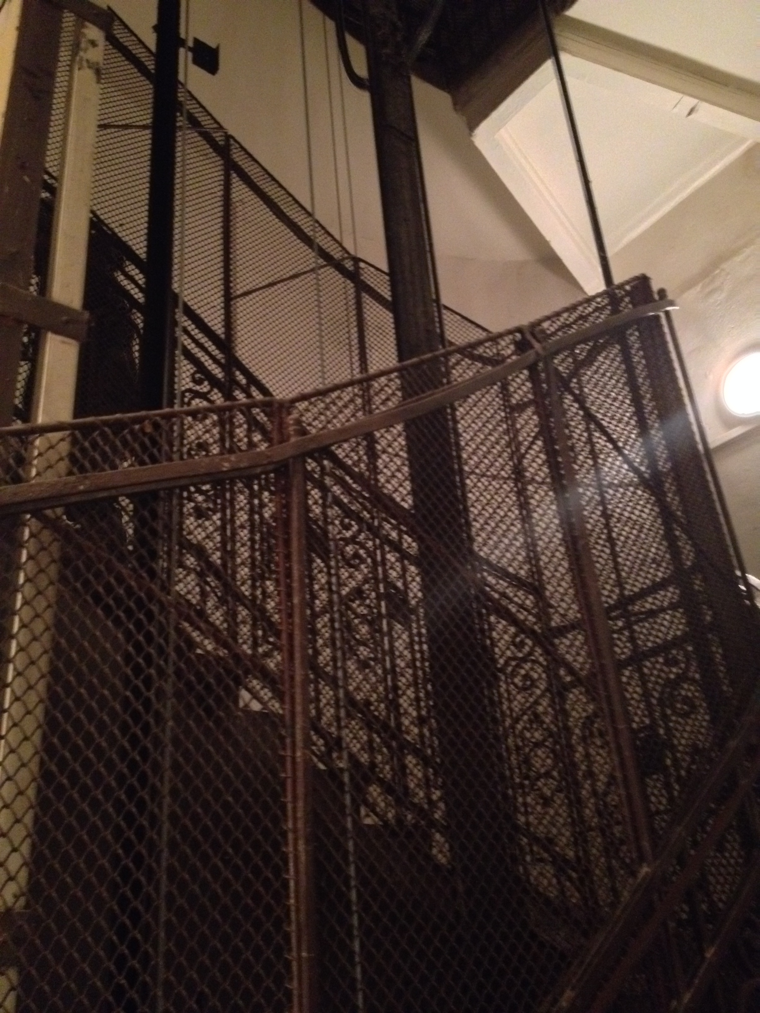We walk up three flights of stairs surrounding this elevator cage. The lights in this building (and most others) are on a timer. The girls freak whenever the lights go out before we get to the door of our school on the third floor--I don't particularly like it either!