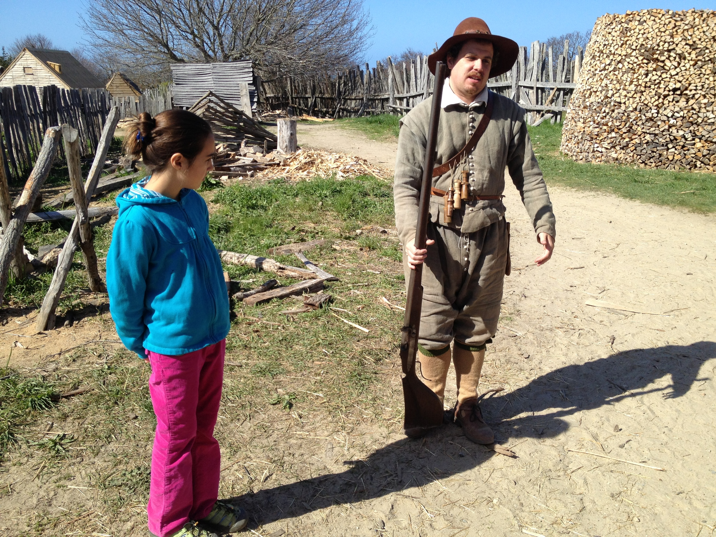 The girls learning from a Plimouth character who reenacted an actual person who sailed on the Mayflower and settled there.