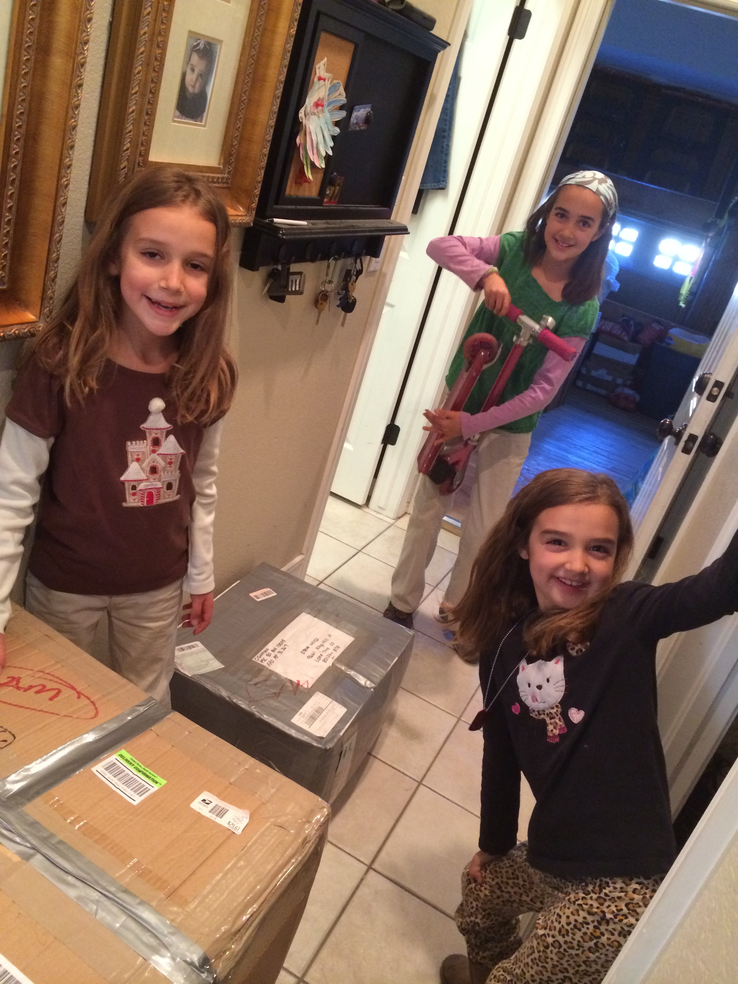Once all the boxes were packed in my in-laws' basement we lugged them upstairs and into the garage. The girls are actually at a helpful age, which is awesome.