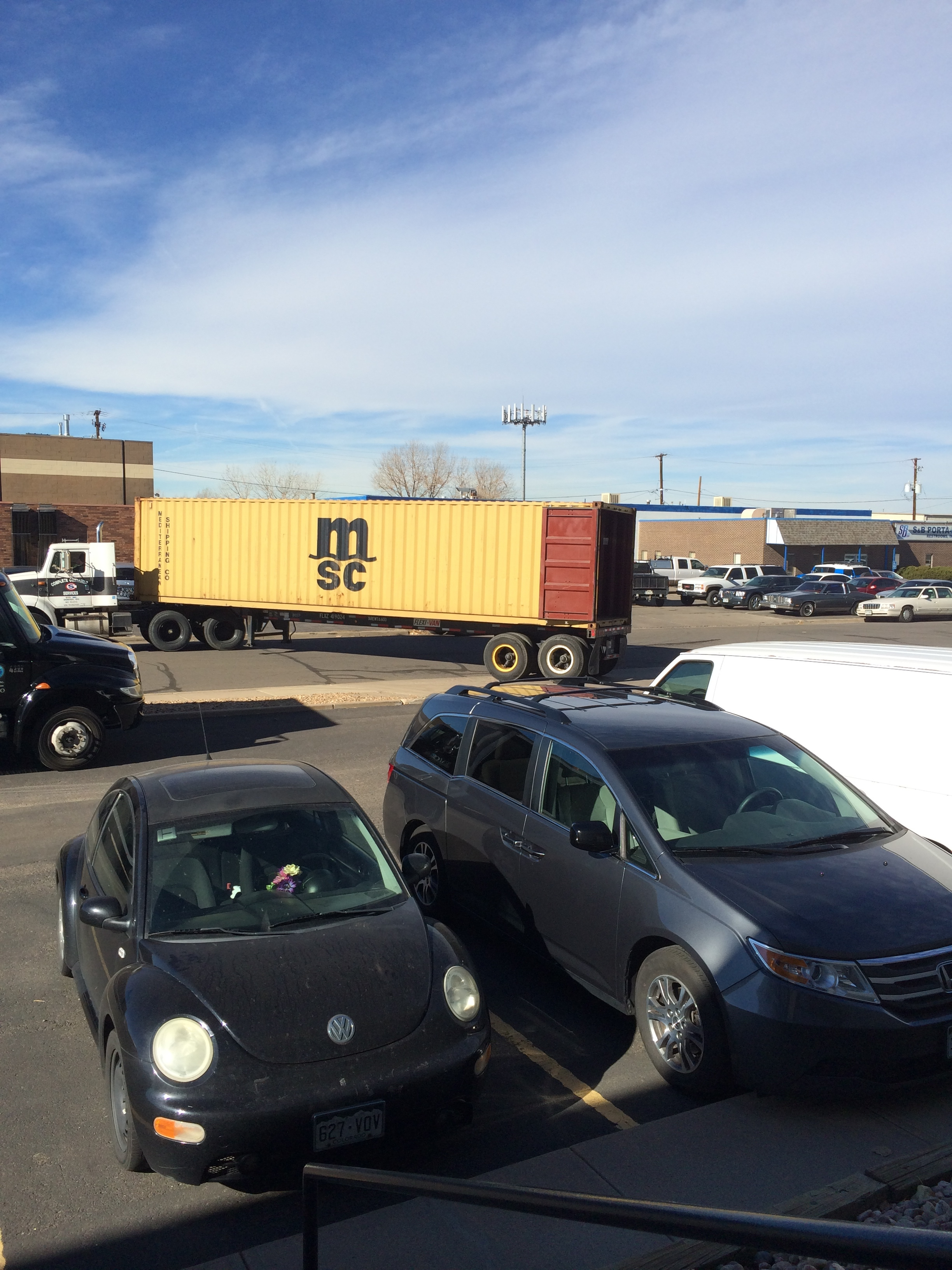 Here comes our container, into which the warehouse guys transferred all of our stuff, built a wall, and then drove our swagger wagon in it (the van pictured in frontwas a gift and cars in Europe are super expensive, so we're taking it with us!).
