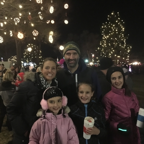 Our family last night at the Christmas Tree lighting on Main Street (minus Rebekah who was hard at work at Kneader's Bakery).