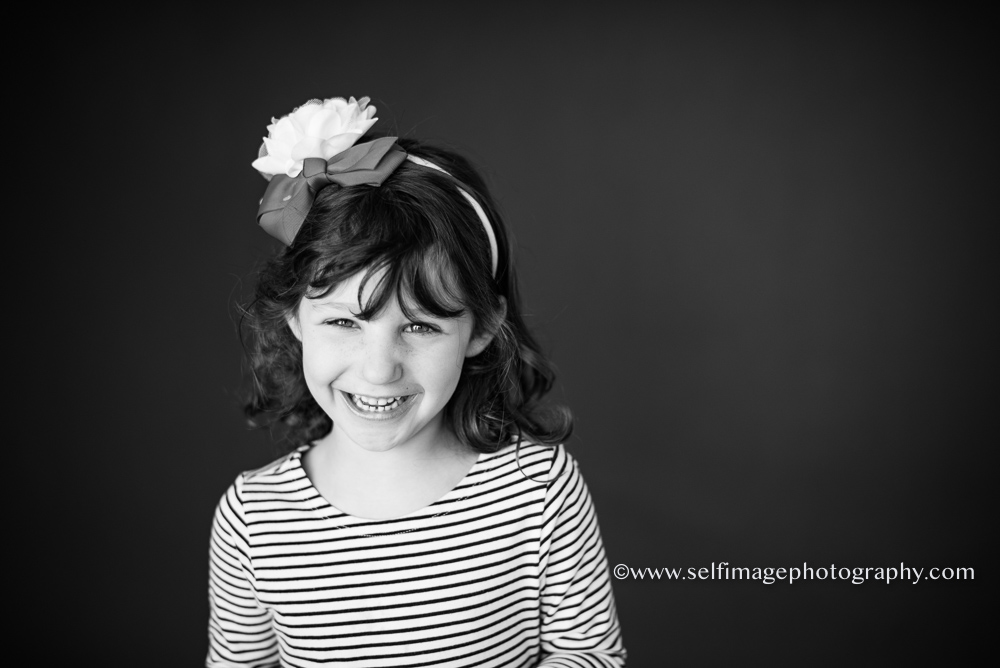 black and white of girl smiling