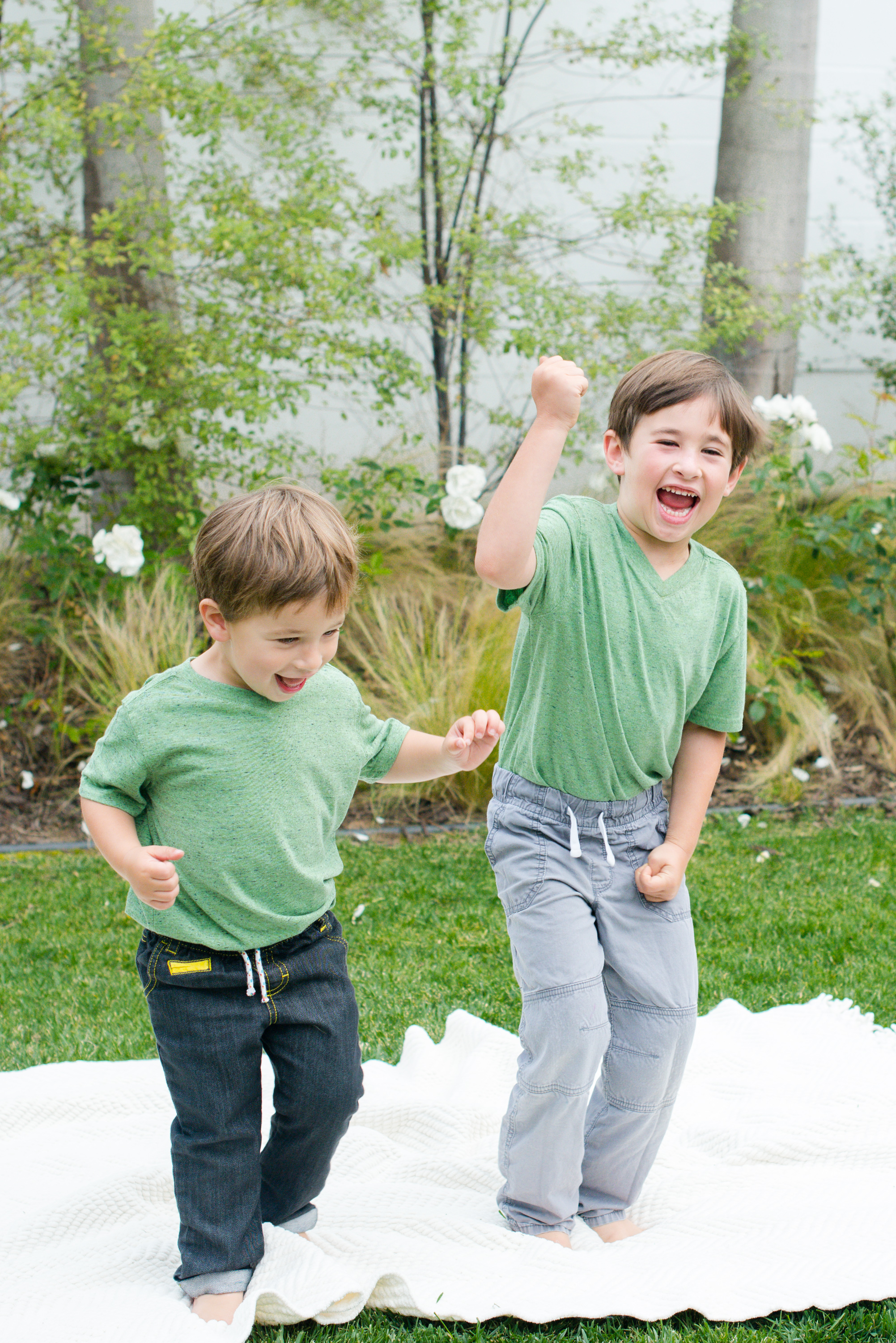 brothers acting silly in their back yard