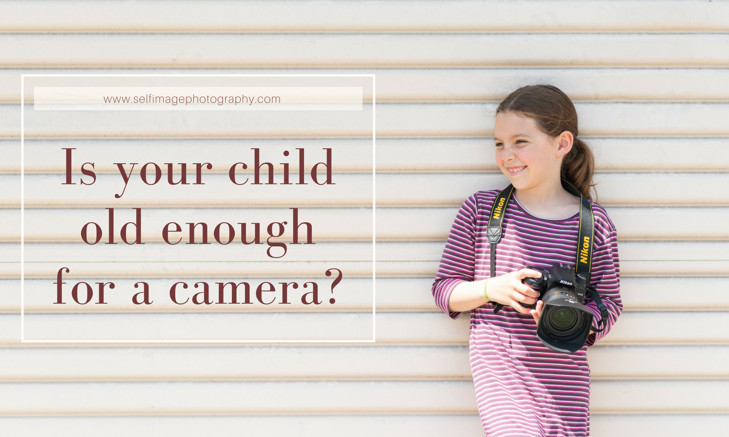 young girl holding DSLR camera