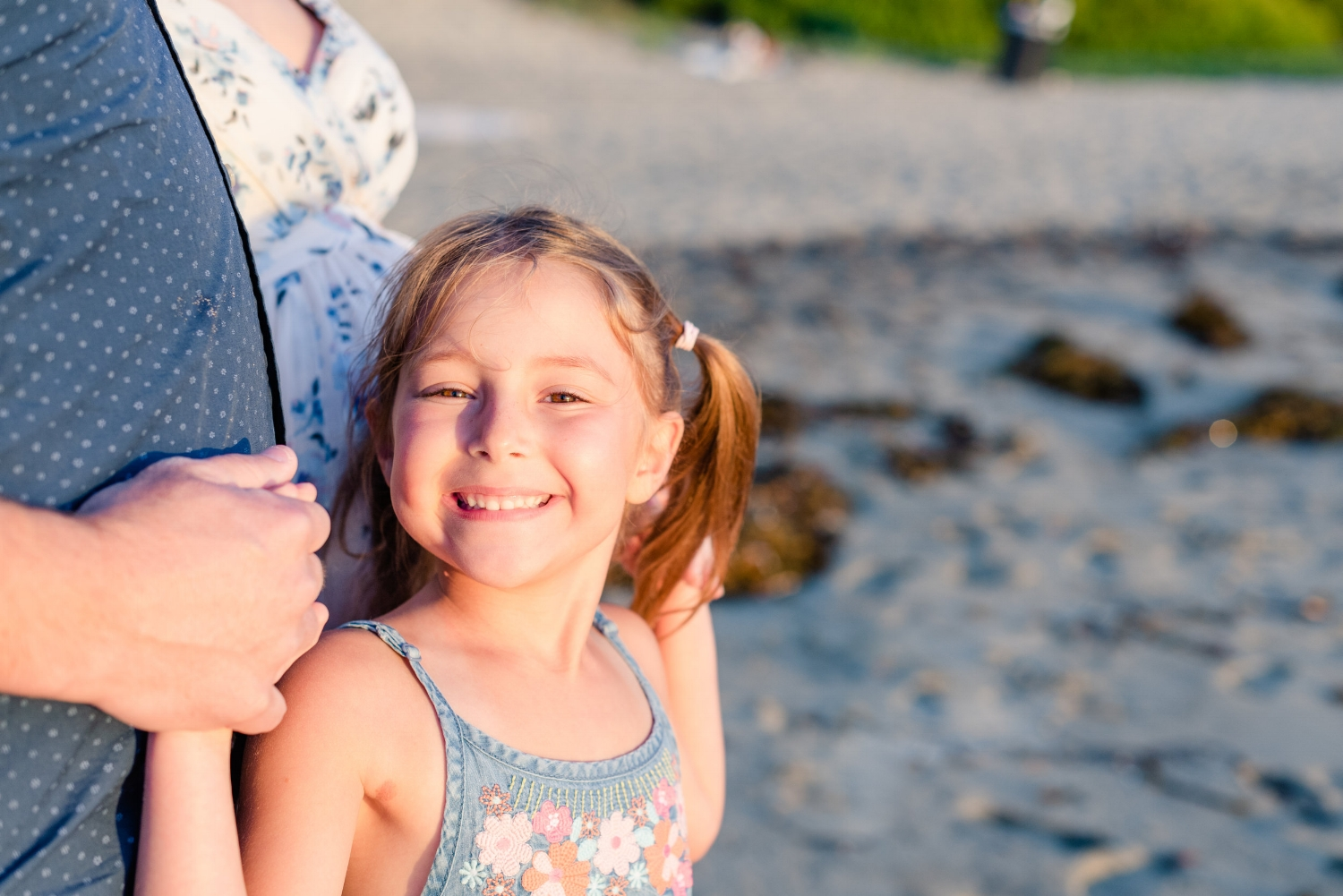little girl smiling at the beach